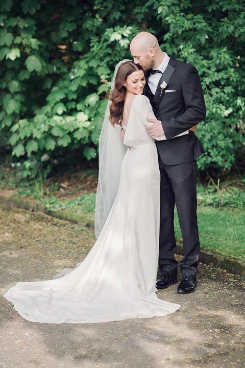 Real bride Siobhán wears our sheer drop veil in chapel length, Caitlyn