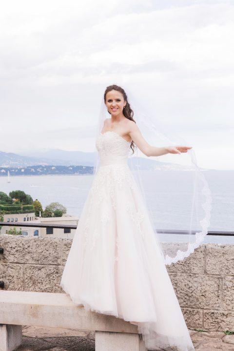 Yelena wears a bespoke lace edge waltz length veil