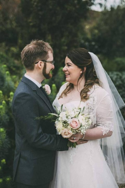 Real bride Alice looks adorable in a blush pink veil made via the Custom Veil Designer
