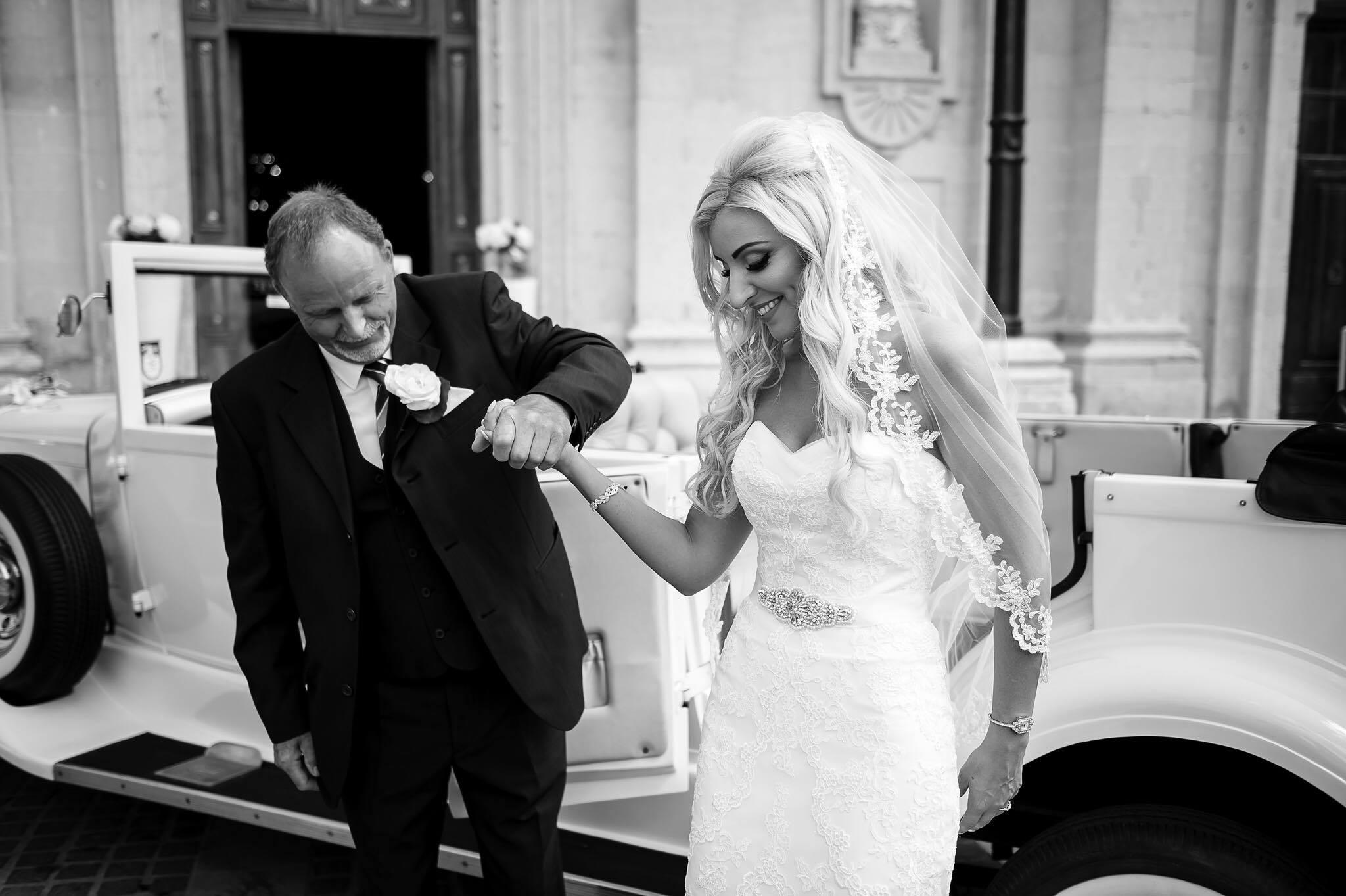 Real Bride Marelda wears a custom lace waterfall cut veil in chapel length